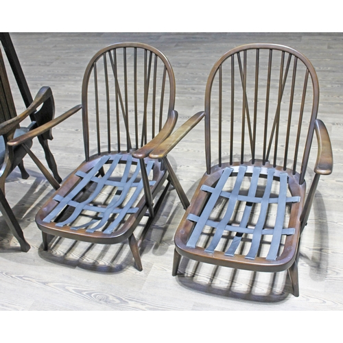 31 - A pair of Ercol dark beech lounge chairs....