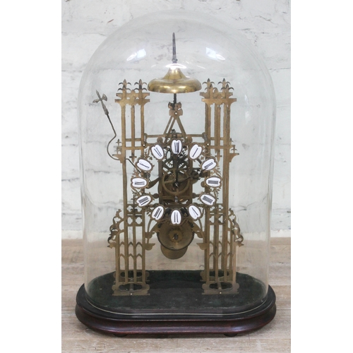 34 - A Gothic revival brass skeleton clock, 20th century, 14.5cm pierced chapter ring with enamel Roman N...