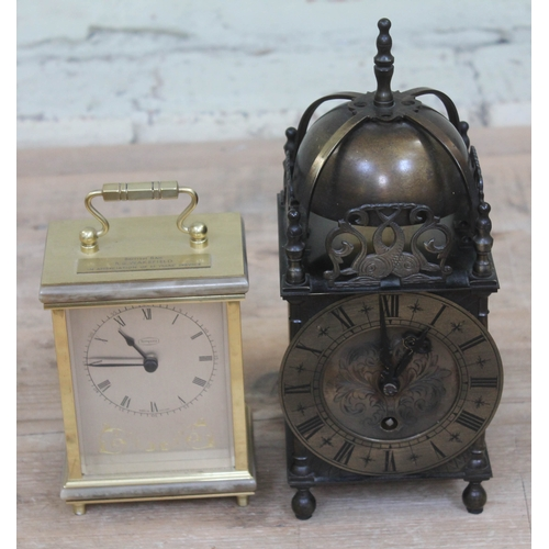 43 - A reproduction lantern clock, the brass movement signed 'Empire', together with a carriage clock....