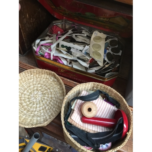 37 - A tin and small basket of sewing items and buttons...