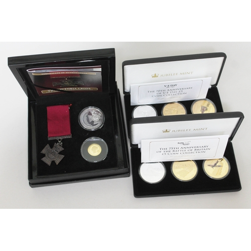 112 - A Victoria Cross commemorative set comprising 9ct gold coin, silver coin and replica VC medal togeth...
