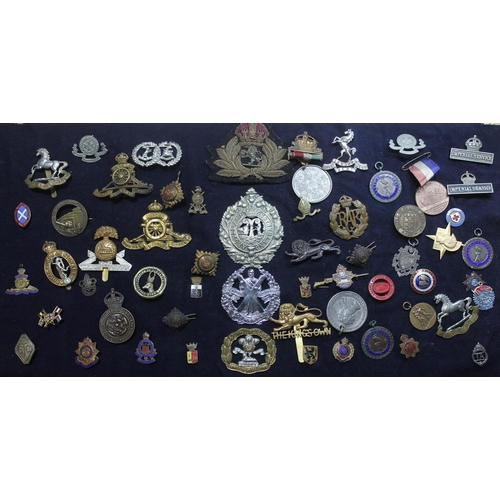 116 - A quantity of regimental cap badges, together with other badges, buttons and commemorative medallion...