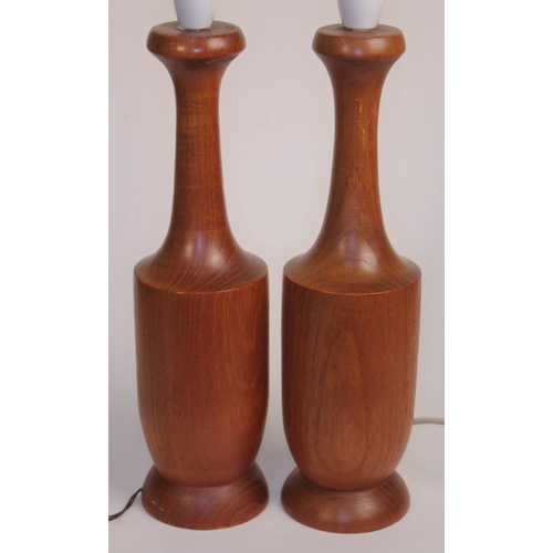 3 - A pair of retro solid teak table lamps of bottle form, probably Danish, height 35.5cm....