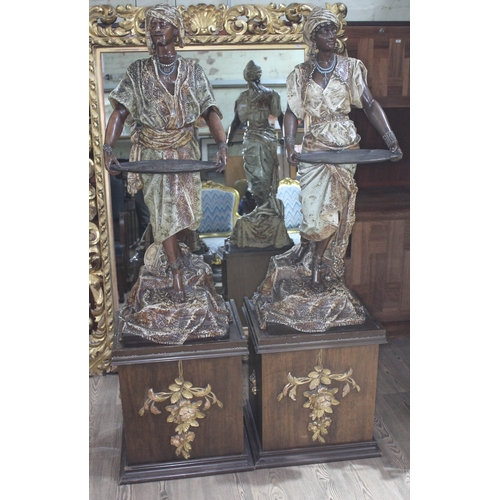 10 - A pair of spelter blackamoor figures with patinated bronze finish, depicting a man and woman and eac...