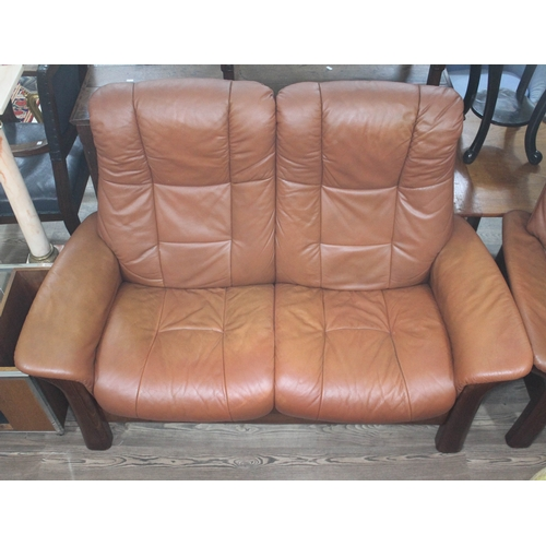23 - A Norwegian Ekornes Stressless tan leather two seater reclining settee....