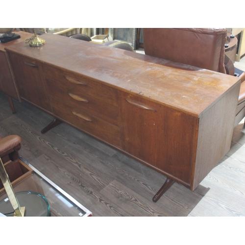 26 - A retro teak sideboard, length 182.5cm....