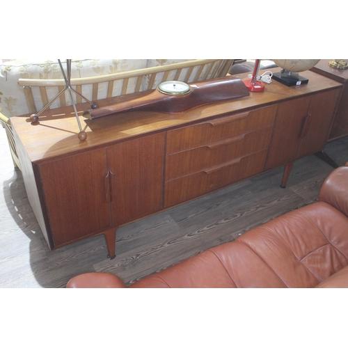 27 - A retro teak sideboard, length 198cm....