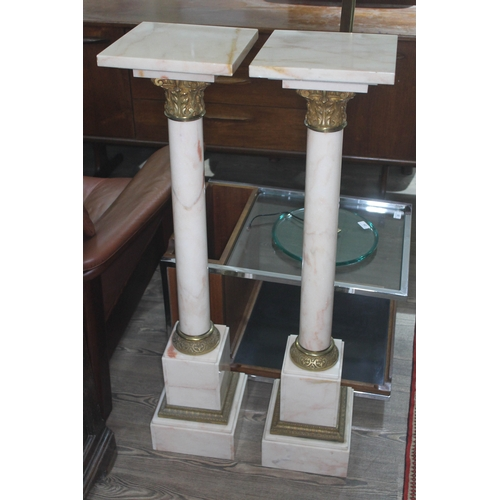 30 - A pair of brass mounted marble plant stands, 20th century, height 105cm....
