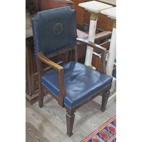 31 - An oak armchair circa 1900, blue upholstery with motif 'The Urban District Council of Ormskirk'....