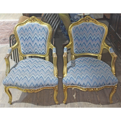 32 - A pair of French giltwood armchairs, 20th century....