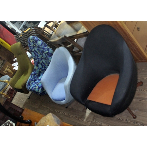 33 - A group of four retro swivel tub chairs, two with teak bases and two with aluminium.(These items may...