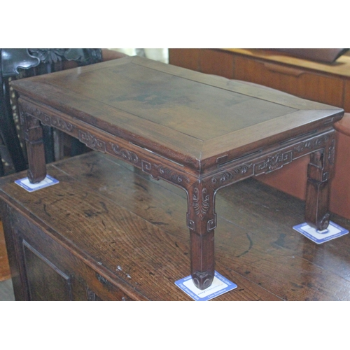 35 - A Chinese hardwood low table, length 77cm, depth 42cm & height 29cm....