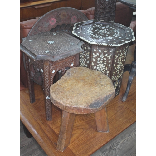 38 - A mixed lot comprising two Moorish tables, a brass top table and a rustic stool labelled 'Wanderwood...