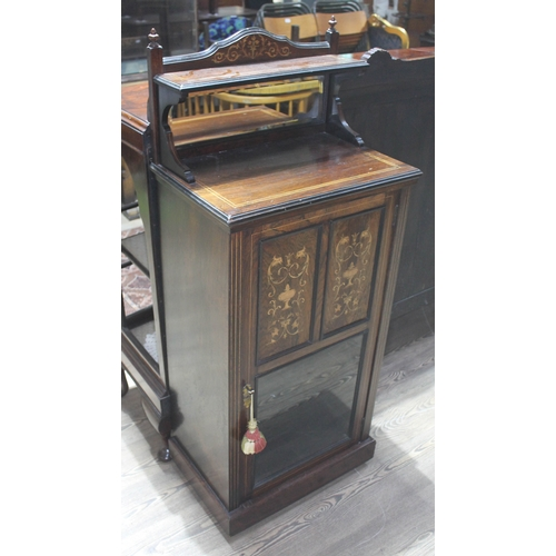 46 - A late Victorian inlaid rosewood music cabinet, height 129cm....