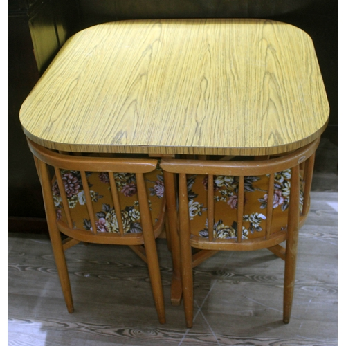 47 - A vintage wood effect kitchen table and four corner chairs with original floral upholstery labelled ...