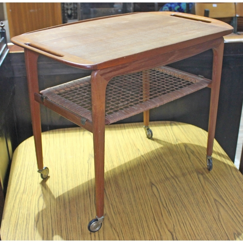 48 - A Danish teak trolley by Silkeborg with lower rattan tier....