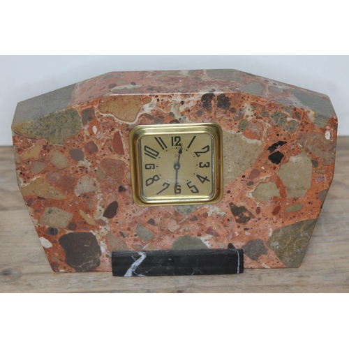 93 - An art deco marble mantel clock, length 22cm....