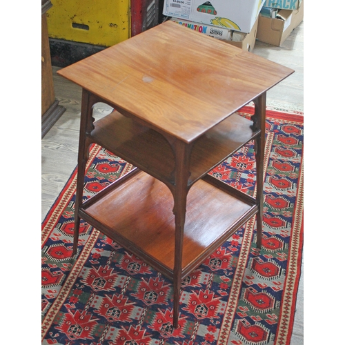 99 - An Edwardian Arts & Crafts style three tier occasional table in the manner of Liberty & Co, height 6...