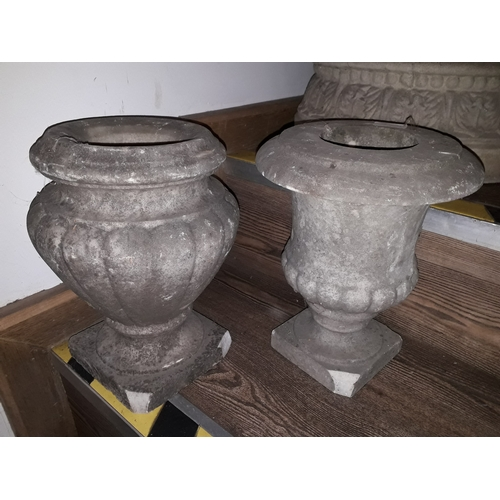 100C - A pair of marble garden urns, height 30cm....