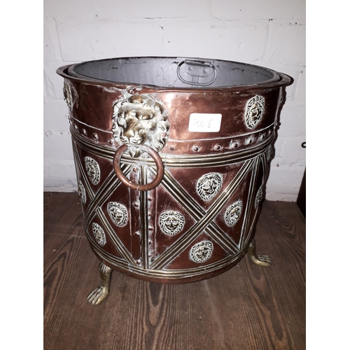100E - A 19th century copper and brass coal bucket, with brass lion head handles, lion feet and galvanised ...