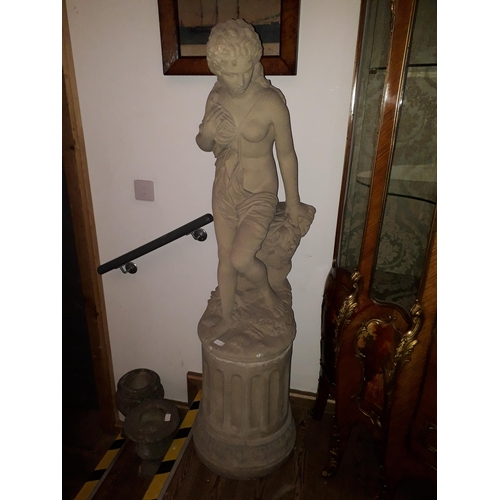 100b - A concrete garden statue depicting a semi nude lady on fluted plinth, height 155cm....