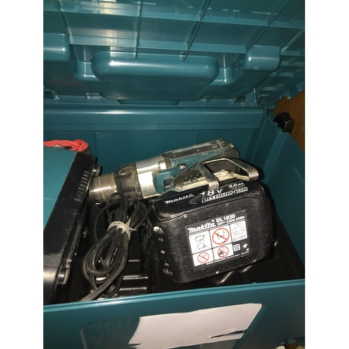 15 - A cased 18v Makita cordless drill charger and 2 batteries...