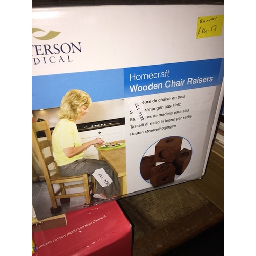 20 - A boxed set of Homecraft wooden chair raisers....