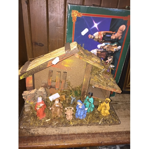 22 - A nativity display and boxed nativity figures...