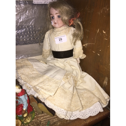 29 - A porcelain doll, signed 'Darling' to rear of neck...