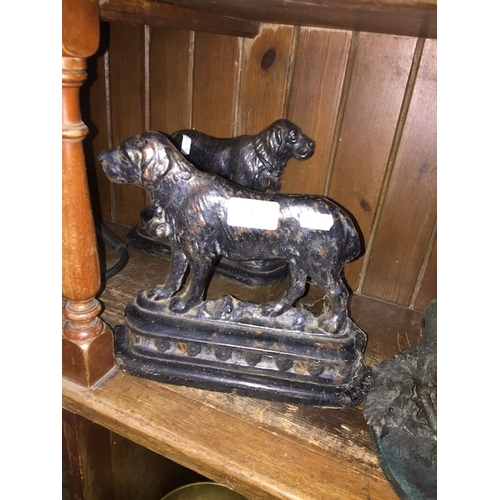 4 - Two cast metal door stops in the form of mountain rescue dogs...
