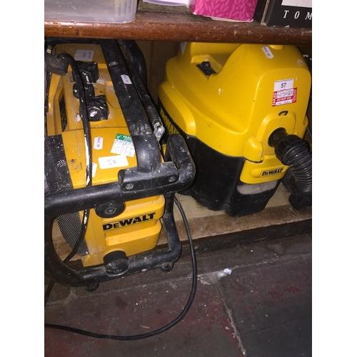 57 - A DeWalt site radio and site vacuum....