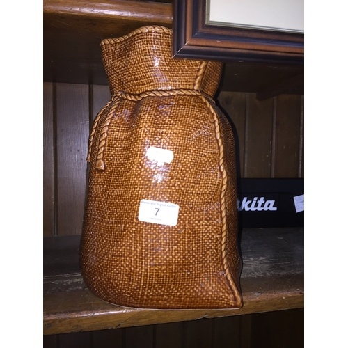 7 - A pottery vase in the form of a sack...