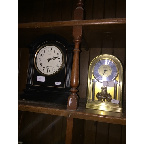 9 - A revolving pendulum mantle clock and another mantle clock...