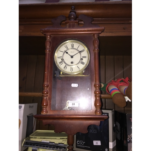 24 - A Hermle wall clock...