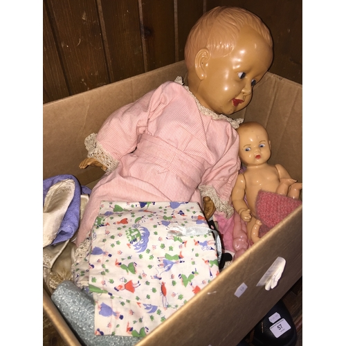 32 - A box of dolls and accessories....