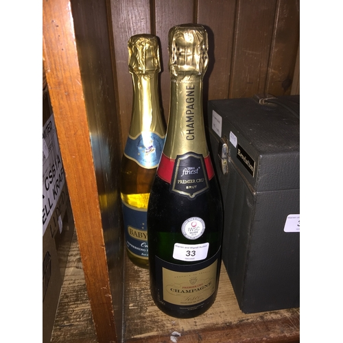 33 - A bottle of Babycham and a bottle of champagne, both sealed and full....