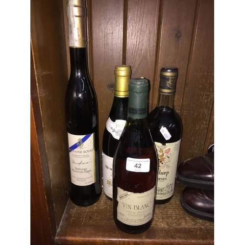 42 - Four bottles of various wines....