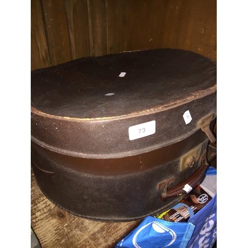 73 - A circular leather hat box....