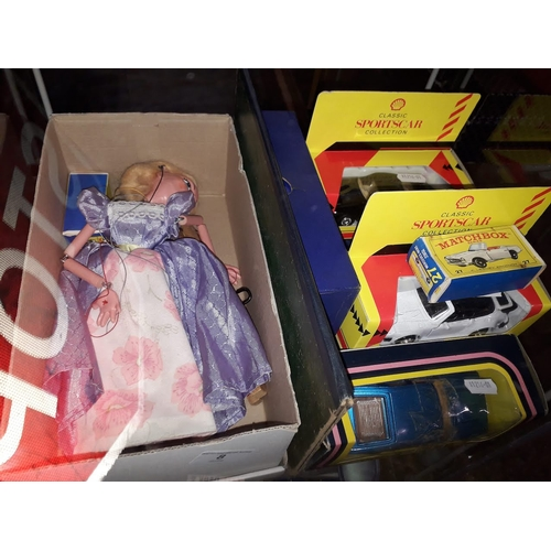 8 - A quantity of toys and games comprising a vintage string puppet, a Corgi Rover 3500, two Lesney Matc...