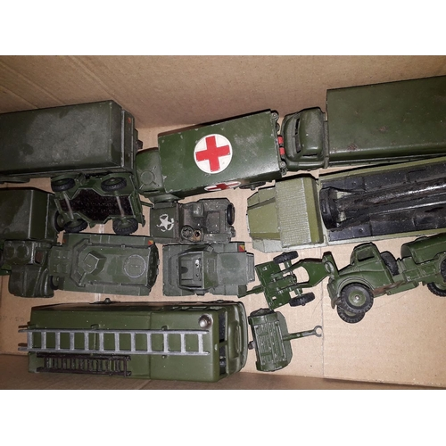 9 - A box of Dinky military model vehicles....