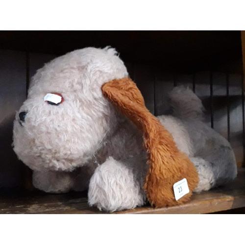 23 - A soft toy dog...