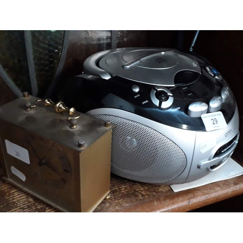29 - Onn portable CD / radio / cassette player with instructions manual and a brass London Clock Co quart...