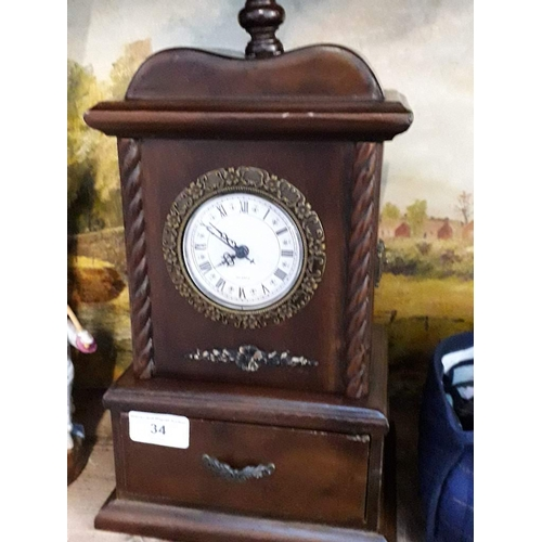 34 - Wooden quartz clock with lower drawer....