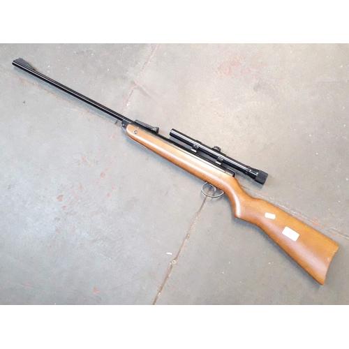 53 - A BSA Meteor .22 caliber air rifle with a Weaver USA scope...