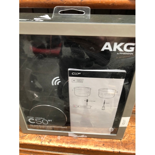 24 - A boxed pair of AKG C50BT headphones...