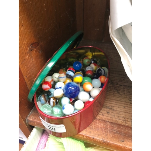 26 - A tin of marbles...