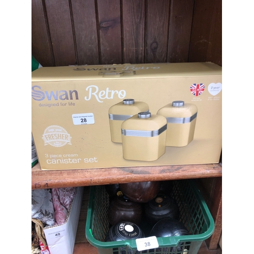 28 - A boxed Swan Retro 3 piece cream canister set....