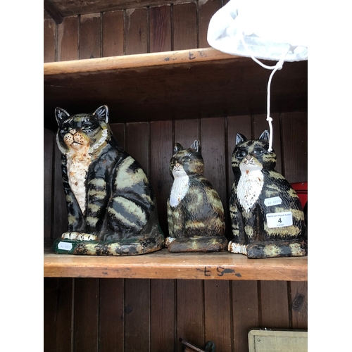 4 - 4 cast door stops - 3 cats and a vintage car....