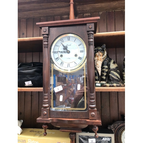 5 - A Lincoln 31 day wall clock with pendulum and key....