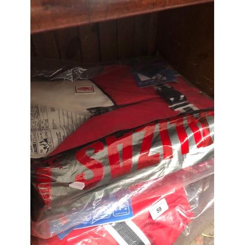 59 - 2 Lalizas life jackets....